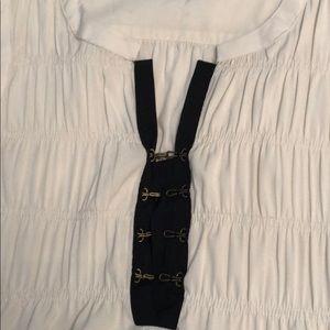 Fun sleeveless top with hook and eye closure